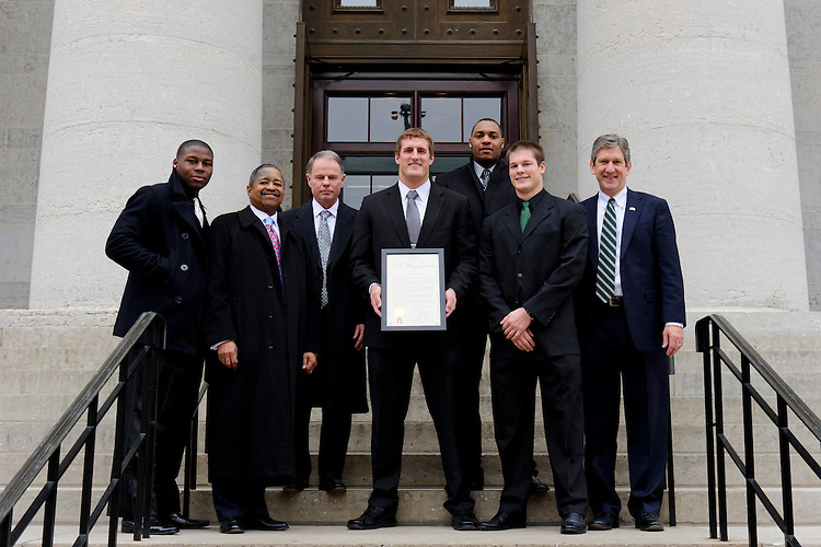 Ohio cornerback Travis Carrie, Ohio University President Roderick J. McDavis, head coach Frank Solich, tight end Jordan Thompson, defensive lineman Tremayne Scott, quarterback Tyler Tettleton, and Athletic Director Jim Schaus are pictured outside the Ohio Statehouse at Capitol Square in Columbus, OH on Tuesday, January 24, 2011. (Joel Hawksley/Ohio University Athletic Department)
