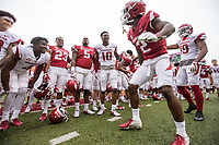 Hawgs Illustrated/BEN GOFF <br /> Kamren Curl (2), Arkansas safety, dances as players celebrate Saturday, April 6, 2019, after the Arkansas Red-White game at Reynolds Razorback Stadium.