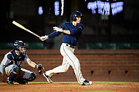 Mobile BayBears second baseman Hutton Moyer (11) follows through on a swing in front of catcher Adrian Nieto (17) during a game against the Pensacola Blue Wahoos on April 25, 2017 at Hank Aaron Stadium in Mobile, Alabama.  Mobile defeated Pensacola 3-0.  (Mike Janes/Four Seam Images)