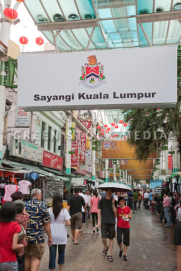 A covered pedestrian street in Chinatown. The overhead sign reads 'Sayangi Kuala Lumpur' (Lovely Kuala Lumpur). Kuala Lumpur, Selangor, Malaysia