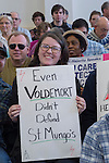 "Westbury, New York, USA. January 15, 2017.  ABAGAEL FAGAN, of Garden City, holds a sign ""Even VOLDEMORT Didn't Defund St. Mungo's"" - referring to the main villain wizard and the Hospital for Magical Maladies and Injuries in the Harry Potter series - at the ""Our First Stand"" Rally against Republicans repealing the Affordable Care Act, ACA, taking millions of people off health insurance, making massive cuts to Medicaid, and defunding Planned Parenthood. Hosts were Reps. K. Rice (Democrat - 4th Congressional District) and T. Suozzi (Dem. - 3rd Congress. Dist.). It was one of dozens of Bernie Sanders' rallies nationwide for health care that Sunday."