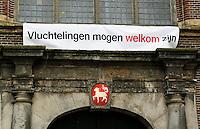 Nederland Utrecht 2015 11 07. Spandoek aan de Janskerk in Utrecht om vluchtelingen welkom te heten.  Foto Berlinda van Dam / Hollandse Hoogte