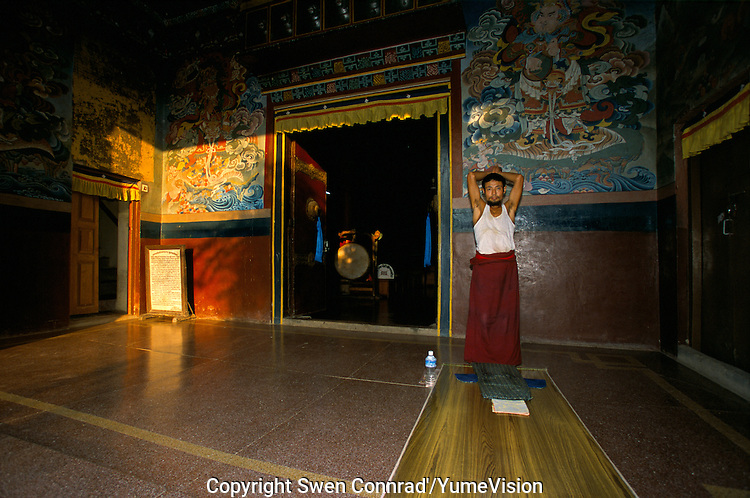 A men pray in the Buddhist temple build by the Tibetans in Lumbini Nepal, marks the birth place of Siddhartha Gautam Buddha..In 1976, the Nepalese Government and UNESCO designated Lumbini as a world heritage site. .-The full text reportage is available on request in Word format