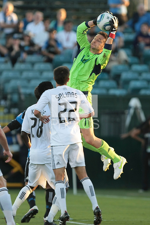 Joe Cannon catches the ball above his teammates Gershon Koffie (28) and Shea Salinas (22). The San Jose Earthquakes tied the Vancouver Whitecaps 2-2 at Buck Shaw Stadium in Santa Clara, California on July 20th, 2011.