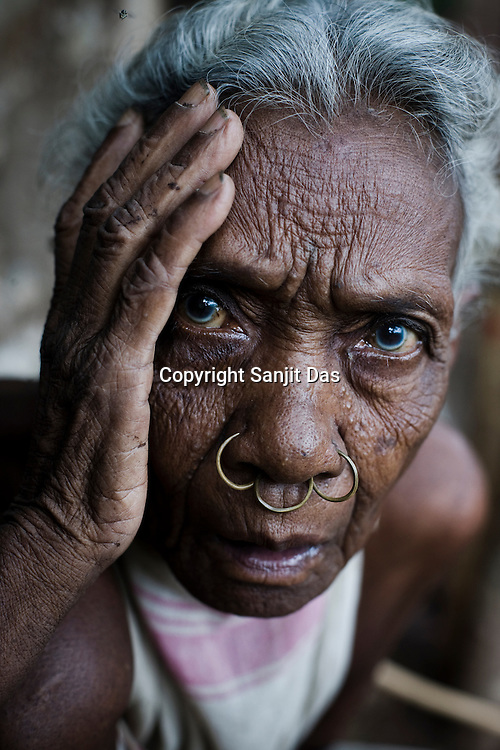 Mai Pusika poses for a portrait in Salpojola village in Niyamgiri hills. She is one of the many people who will get displaced if the aluminium company Vedanta carries on with its plans of mining of Bauxide in Niyamgiri hills in Rayagara district of Orissa in India.