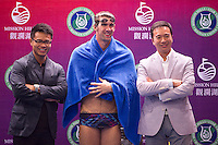 HAIKOU, CHINA - OCTOBER 30:  Multiple Olympic gold medalist Michael Phelps C() of USA poses with Tenniel Chu (R), Executive Director of Mission Hills Golf Club and  Dr. Ken Chu, Vice Chairman of Mission Hills Group during a promotional event on day four of the Mission Hills Start Trophy tournament at Mission Hills Resort on October 30, 2010 in Haikou, China. The Mission Hills Star Trophy is Asia's leading leisure liflestyle event and features Hollywood celebrities and international golf stars. Photo by Victor Fraile / studioEAST