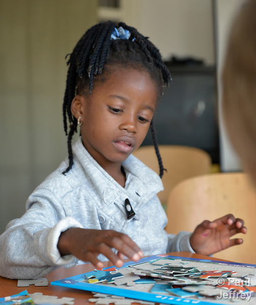 A refugee girl from Sudan plays in a child care program in a government-run refugee center in Vamosszabadi, Hungary. Hungarian Interchurch Aid, a member of the ACT Alliance, provides the child care and other services to residents in the center, who come from Syria, Iraq and other countries and are bound for western Europe.
