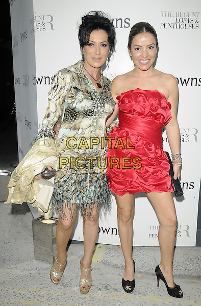 NANCY DELL'OLIO & ELEN RIVAS .At the Browns 40th Anniversary dinner & auction, the Regent Penthouse & Lofts, London, England, UK, May 20th 2010..full length red strapless dress peep toe black shoes feathers feather green beige print gold platform YSL sandals .CAP/CAN.©Can Nguyen/Capital Pictures.