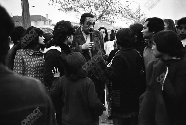 Friends and family of political prisoners captured on the days following the September 11, 1973 military coup gather before the National Stadium, where the prisoners were held.  Santiago, Chile, September 1973.