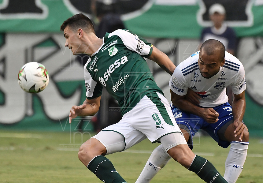 PALMIRA - COLOMBIA, 03-03-2019: Juan David Perez del Cali disputa el balón con Luis Payares de Millonarios durante partido por la fecha 8 de la Liga Águila I 2019 entre Deportivo Cali y Millonarios jugado en el estadio Deportivo Cali de la ciudad de Palmira. / Juan Ignacio Dinenno of Cali vies for the ball with Luis Payares of Millonarios during match for the date 8 as part Aguila League I 2019 between Deportivo Cali and Millonarios played at Deportivo Cali stadium in Palmira city.  Photo: VizzorImage / Gabriel Aponte / Staff