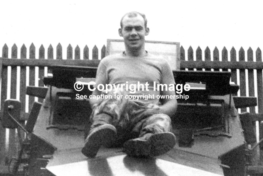 Off-duty photo of Private Malcolm Hatton, 19 years, married, Green Howards Regiment, British Army, relaxing on top of an armoured personnel carrier. Private Hatton died on 9th August 1971 during a pitched gun battle between troops and the Provisional IRA in the Ardoyne area of N Belfast. 197108090524...Copyright Image from Victor Patterson, 54 Dorchester Park, Belfast, United Kingdom, UK...For my Terms and Conditions of Use go to http://www.victorpatterson.com/Victor_Patterson/Terms_%26_Conditions.html