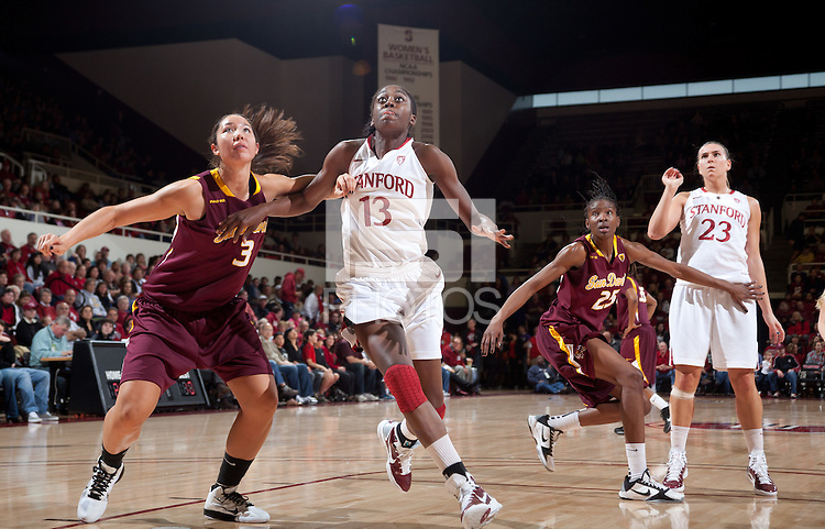 STANFORD, CA - January 8, 2011: Chiney Ogwumike and Jeanette Pohlen of the Stanford Cardinal women's basketball team during Stanford's game against Arizona State at Maples Pavilion. Stanford won 82-35.