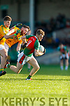 20-1-19 AIB GAA Football All-Ireland Intermediate Club Championship, Semi Final between Kilcummin, and Two Mile House in the Gaelic Grounds, Limerick.<br /> Gary O'Leary, Kilcummin breaks away from Jack Collins and Nathan Sherry, Two Mile House.<br /> Picture: Keith Wiseman