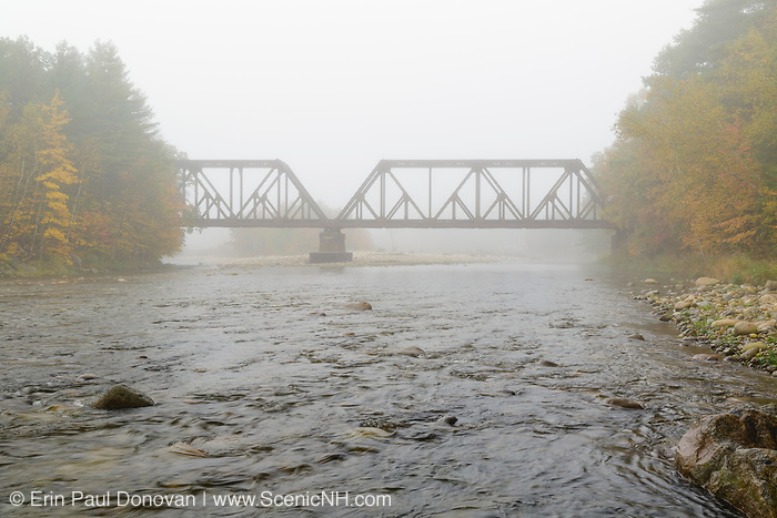 Trestle at the East Branch of the Pemigewasset River crossing along the old Boston & Maine Railroad's Pemigewasset Valley Railroad in North Woodstock, New Hampshire on a foggy autumn day.