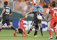 Andy Najar #14 of D.C. United gets the ball as Julian de Guzman #6 of Toronto FC crashes to the ground during an MLS match that was the final appearance of D.C. United's Jaime Moreno at RFK Stadium, in Washington D.C. on October 23, 2010. Toronto won 3-2.
