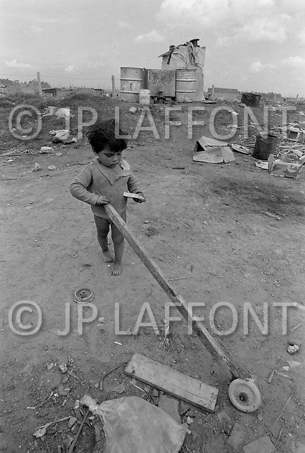 Children work in garbage dump in Bogota, Colombia - Child labor as seen around the world between 1979 and 1980 – Photographer Jean Pierre Laffont, touched by the suffering of child workers, chronicled their plight in 12 countries over the course of one year.  Laffont was awarded The World Press Award and Madeline Ross Award among many others for his work.