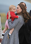 AUSTRALIA, Canberra : Britains Catherine, Duchess of Cambridge (R)  holds Prince William (L) before bording the plane at Defence Base Fairbairn to leave Australia, Canberra on April 25, 2014. Britain's Prince William, his wife Kate and their son Prince George were on a three-week tour of New Zealand and Australia. AFP PHOTO / Mark GRAHAM