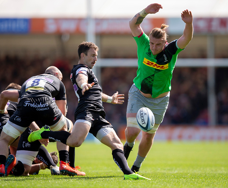 Exeter Chiefs' Nic White is almost charged down by Harlequins' Stan South<br /> <br /> Photographer Bob Bradford/CameraSport<br /> <br /> Gallagher Premiership - Exeter Chiefs v Harlequins - Saturday 27th April 2019 - Sandy Park - Exeter<br /> <br /> World Copyright © 2019 CameraSport. All rights reserved. 43 Linden Ave. Countesthorpe. Leicester. England. LE8 5PG - Tel: +44 (0) 116 277 4147 - admin@camerasport.com - www.camerasport.com