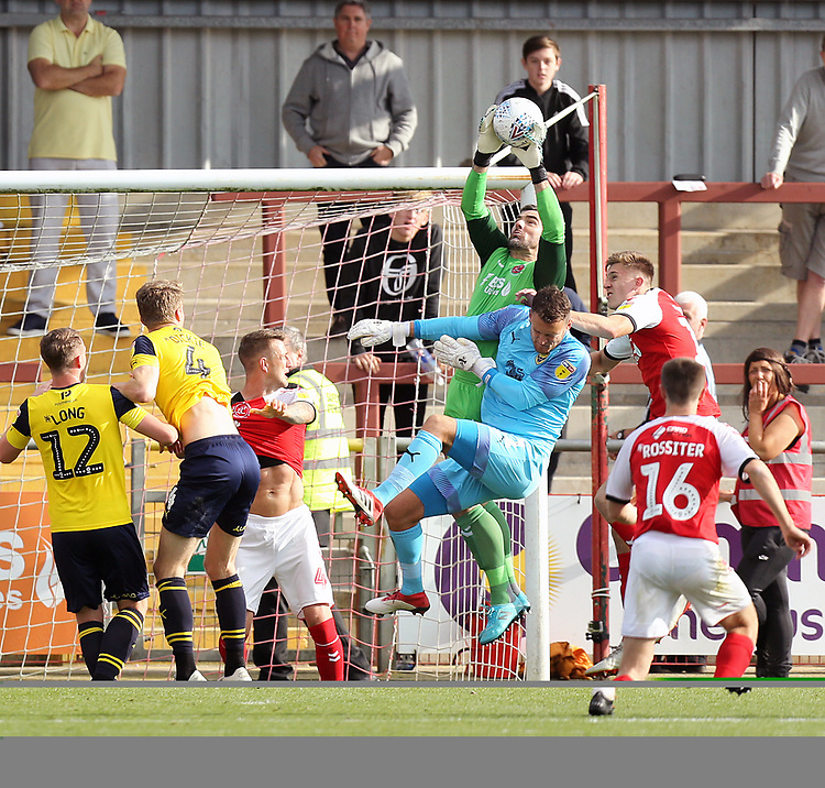 Fleetwood Town's Matthew Gilks gathers late in the game despite the attentions of Oxford United's Simon Eastwood<br /> <br /> Photographer Rich Linley/CameraSport<br /> <br /> The EFL Sky Bet League One - Fleetwood Town v Oxford United - Saturday 7th September 2019 - Highbury Stadium - Fleetwood<br /> <br /> World Copyright © 2019 CameraSport. All rights reserved. 43 Linden Ave. Countesthorpe. Leicester. England. LE8 5PG - Tel: +44 (0) 116 277 4147 - admin@camerasport.com - www.camerasport.com