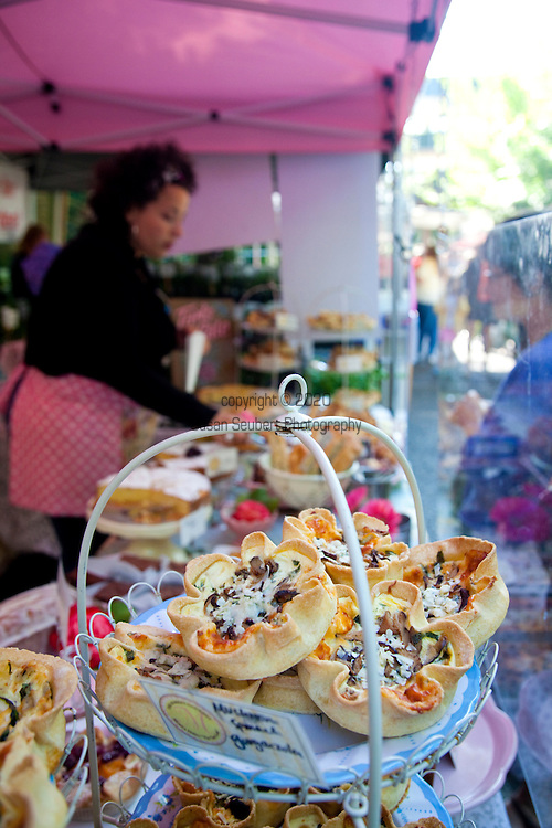 The Portland Farmers' Market on Saturday Mornings in the South Park Blocks offers fresh, organic and locally grown produce, meat, fish and other food products. Pictured here are freshly made tarts by the Market Gourmet who travel to the market from Hood River, OR.