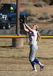 Wildcat Jennie Quam makes a catch in the outfield during a college softball game against Salt Lake Community College, on Friday, Feb. 15, 2013, in Carson City, Nev. SLCC won the opener 4-2..Photo by Cathleen Allison