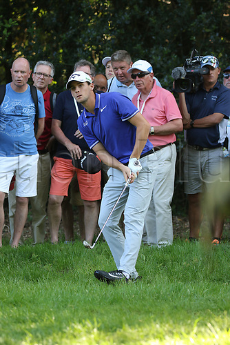 May 25th 2017, Virginia Water, Wentworth, Surrey, England; BMW PGA Championship golf, day 1; Thomas Pieters of Belgium watches his recovery shot from the rough on the 17th
