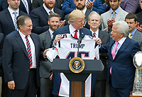 United States President Donald J. Trump, center, holds up the Super Bowl LI jersey with head coach Bill Belichick, left, and New England Patriots owner Robert Kraft, right, as the President welcomes the Super Bowl Champions to the South Lawn of White House in Washington, DC on Wednesday, April 19, 2917.<br /> Credit: Ron Sachs / CNP/MediaPunch<br /> <br /> (RESTRICTION: NO New York or New Jersey Newspapers or newspapers within a 75 mile radius of New York City)