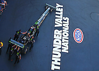 Jun 17, 2016; Bristol, TN, USA; Crew members with NHRA top fuel driver Brittany Force during qualifying for the Thunder Valley Nationals at Bristol Dragway. Mandatory Credit: Mark J. Rebilas-USA TODAY Sports
