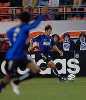 Colorado Rapids defender Ritchie Kotschau serves a ball to waiting forward Jeff Cunningham. The Colorado Rapids lost to the LA Galaxy 2-0 in the Western Conference Finals, November 5, 2005, at Ivesco Field at Mile High in Denver, CO.
