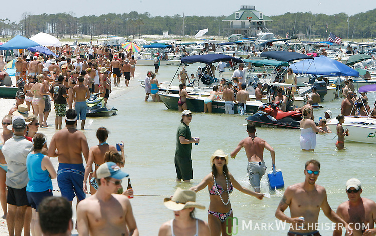 Over 350 boats carrying thousands of celebrants packed a one mile streatch of beach at the 2006 White Trash Bash on Dog Island Florida May 28, 2006.  Arriving by boat is the only way to reach the remote Dog Island off the coast of Carrabelle, FL.  75 miles south of Tallahassee and is a yearly boat pary held on Memorial Day weekend to celebrate the holiday and the end of school.    (Mark Wallheiser/TallahasseeStock.com)