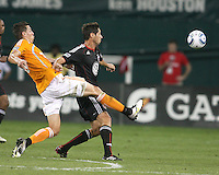Branko Boskovic #27 of D.C. United loses the ball to Geoff Cameron #20 of the Houston Dynamo during an MLS match at RFK Stadium in Washington D.C. on September  25 2010. Houston won 3-1.