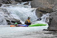 Chris Ryman, Carl Jacks and friends paddle a waterfall on the Kaslo River, Selkirk Mountains, BC