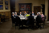 United States President Barack Obama hosts a working dinner in Laurel Cabin during the G8 Summit at Camp David, Maryland, May 18, 2012. Seated clockwise from the President are: Prime Minister David Cameron of the United Kingdom, Prime Minister Dmitry Medvedev of Russia, Chancellor Angela Merkel of Germany, Herman Van Rompuy, President of the European Council, José Manuel Barroso, President of the European Commission, Prime Minister Yoshihiko Noda of Japan, Prime Minister Mario Monti of Italy, Prime Minister Stephen Harper of Canada, and President François Hollande of France. .Mandatory Credit: Pete Souza - White House via CNP