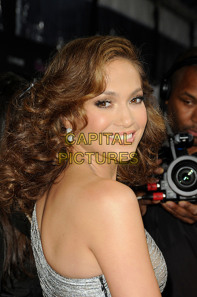 "JENNIFER LOPEZ .arriving at the premiere of CBS Films' ""The Back-up Plan"" at the Regency Village Theatre in Westwood, California, USA, April 21st, 2010..arrivals portrait headshot one shoulder silver earring wavy hair smiling looking back over .CAP/ROT.©Lee Roth/Capital Pictures"