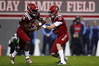 RALEIGH, NC - NOVEMBER 30: Devin Leary #13 of North Carolina State University hands the ball to Zonovan Bam Knight #24 during a game between North Carolina and North Carolina State at Carter-Finley Stadium on November 30, 2019 in Raleigh, North Carolina.