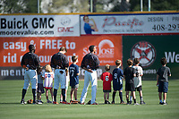 San Jose Giants outfielders Jacob Heyward (33), Bryce Johnson (28), and Johneshwy Fargas (49) stand alongside members of a youth baseball league during the National Anthem before a California League game against the Lancaster JetHawks at San Jose Municipal Stadium on May 12, 2018 in San Jose, California. Lancaster defeated San Jose 7-6. (Zachary Lucy/Four Seam Images)