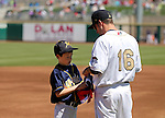 Reno Aces' Tyler Bortnick talks with Adam Garren at third base before a baseball game against the Sacramento River Cats in Reno, Nev., on Sunday, April 14, 2013. The River Cats won 22-6..Photo by Cathleen Allison