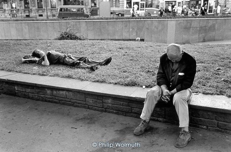 Drunks asleep outside the main railway station in Krakow.