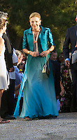 Empress Farah Pahlavi of Iran attends The Wedding of Prince Nikolaos of Greece and Tatiana Blatnik at the monastery of Ayios Nikolaos on the Island of Spetses, Greece.