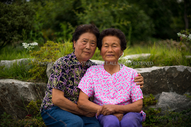 9/9/13 -- Jeungdo Island, Jeonnam Province (Jeollanam-do), South Korea<br /> <br /> Biseulan Newsletter. HERE: Jung Kum Sun, 81 years old (right)<br /> <br /> Photograph by Stuart Isett<br /> &copy;2013 Stuart Isett. All rights reserved.