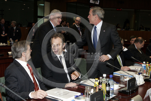 "BRUSSELS - BELGIUM - 22 FEBRUARY 2005 --EU-US Summit.--The President of the United States of America George W. BUSH greeting the German Minister of Foreign Affairs Joschka FISCHER (2ndL), who came to meeting of the Heads of State from the meeting of the Foreign Affairs Ministers. The Austrian Chancellor Wolfgang SCHÜSSEL (L) (Schuessel) with the British Prime Minister Tony BLAIR (C).--  PHOTO: JUHA ROININEN / EUP-IMAGES..This picture is copyright EUP-IMAGES and all rights belong to EUP-IMAGES. The picture may not be subject to RESALE or storage in any kind in electronical or analog way.  If published due to the above EU-US summit meeting in Brussels in print or electronical form the publication must inform on the use to the e-mail address ""eup@eup-images.com"". All further use of this picture may only be done by contacting www.eup-images.com..."