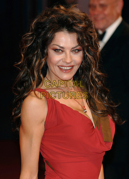 "EVA GRIMALDI.At the Premiere of ""The Fine Art of Love-Mine Ha-Ha""..62nd International Film Festival,.Venice, 31st August 2005.portrait headshot red plunging neckline dress cleavage .Ref: PL.www.capitalpictures.com.sales@capitalpictures.com.©Capital Pictures.."