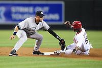 Jun. 22, 2010; Phoenix, AZ, USA; New York Yankees shortstop Derek Jeter tags out Arizona Diamondbacks base runner Justin Upton on a stolen base attempt in the second inning at Chase Field. Mandatory Credit: Mark J. Rebilas-