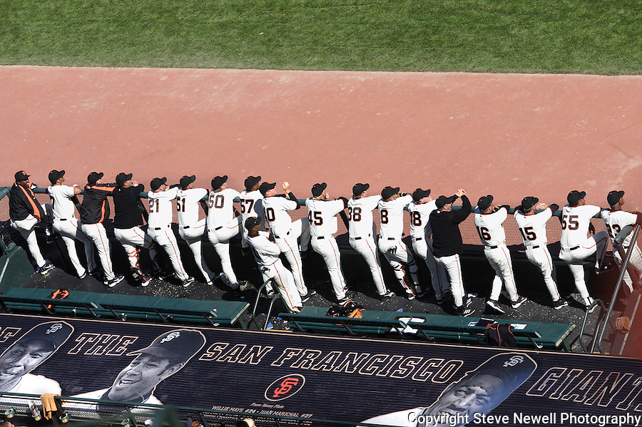 The San Francisco Giants Team out on their dugout during an Opening Day game vs the LA Dodgers.