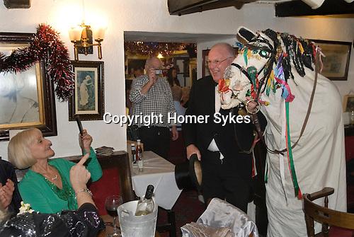 Mari Lwyd, Llangynwyd near Bridgend Glamorgan bringing in the New Year December 31st 2012. Gwyn Evans, Ostler leads the Mari at the Old House Inn, Llangynwyd.