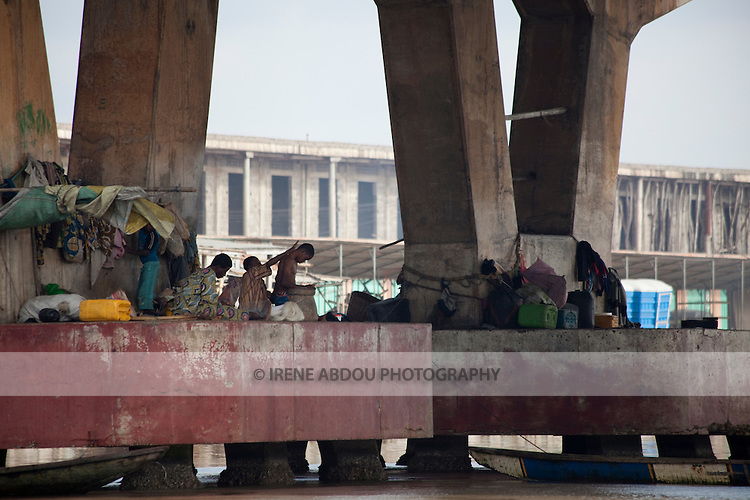 Residents take shelter under a bridge in Benin's capital city of Cotonou.