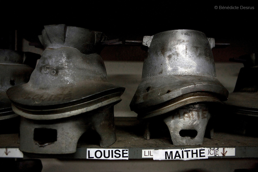 9 december 2009 - Coustilleres' hat factory, Septfonds, France - Metal hat molds that are used to make the hat shapes. Septfonds is the heart of French straw hat making, due to its very ancient hatter tradition. The hat making industry had its commercial peak in the late 19th century..Coustillères is a family owned hat making factory that has been making straw hats in Septfonds for nearly 100 years. They make hats from straw, felt, and cloth as well as caps. The current owner is Jean-Claude Coustilleres. He is one of the last hat makers of the region..The straw hat making process is very labor intensive and numerous hands are involved. Nearly all of the equipment is over 100 years old, they use the original presses and tools including aluminium molds and sewing machines and dye their own straw continuing the traditional methods of manufacturing. The hat blocking and shaping, straw braids construction and dyeing are all done by hand..The company works on behalf of fashion houses and makes a variety of regional and historical hats. It produces 2 collections a year distributed by a network of salespeople and through a catalog to clients around the world. Photo credit: Benedicte Desrus