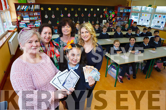 Nine-year-old Rí-Ann Zhang wrote a book 'Daphne and Dora' and donated €600 Clogher NS, where she attends. Pictured were: Sinead Murphy (Principal), Angie Baily (mom), Peggy Linnane (Class Teacher) and Sinead Reidy and Rí-Ann's classmates.