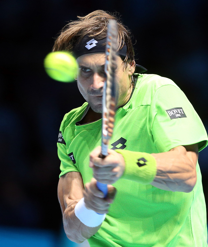 David Ferrer of Spain in action against Stanislas Wawrinka of Switzerland<br /> <br /> Photo by Rob Newell/CameraSport<br /> <br /> International Tennis - Barclays ATP World Tour Finals - O2 Arena - London - Day 5 -  Fridday 8th November 2013<br /> <br /> &copy; CameraSport - 43 Linden Ave. Countesthorpe. Leicester. England. LE8 5PG - Tel: +44 (0) 116 277 4147 - admin@camerasport.com - www.camerasport.com