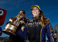 Mar 30, 2014; Las Vegas, NV, USA; NHRA funny car driver Alexis DeJoria celebrates after winning the Summitracing.com Nationals at The Strip at Las Vegas Motor Speedway. Mandatory Credit: Mark J. Rebilas-USA TODAY Sports